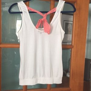 Adorable white tank with pink polka dot tie back